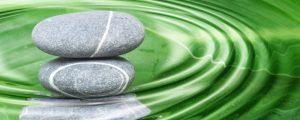 rocks in a ripple of water