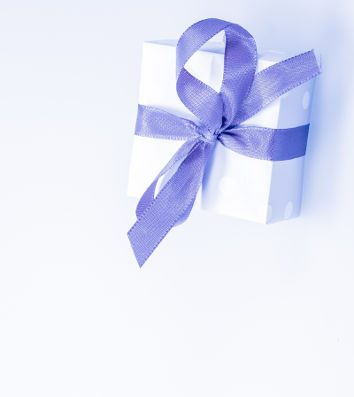 A white gift package with a blue bow