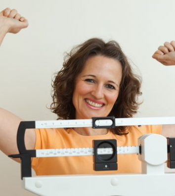 woman happy with what the scale says
